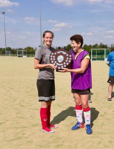 Laura Whittle & Issy MacMillan receiving winners shield