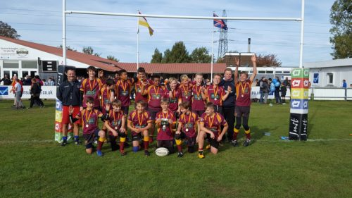 U13s rugby team photo with medals