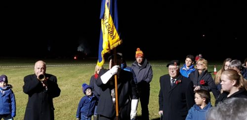 British Legion holding the flag at Rememberence day beacon